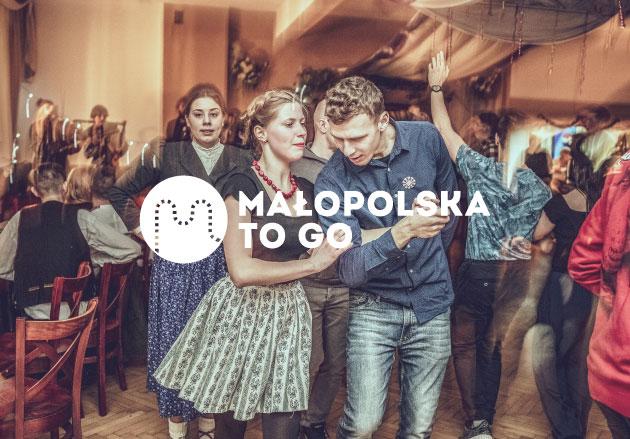 Malopolska To Go logo on a photo of dancing couple