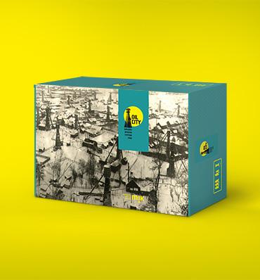 pudełko z grą Oil City na żółtym tle
