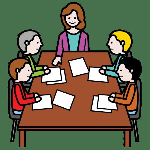 Osoby siedzące przy stole